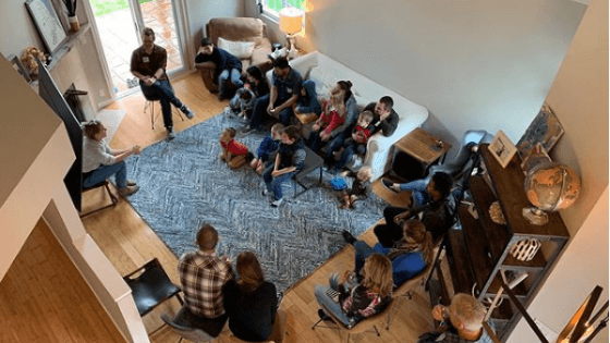 Group of people meet in a living room